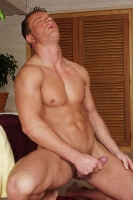 Handsome hunk grabs his dick